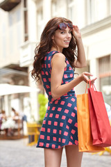 Young beautiful woman with shopping bags in the ctiy- Let's go s