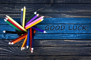 Good Luck text painted and group of pencils