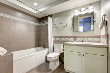 Clean bathroom interior with brown tile.