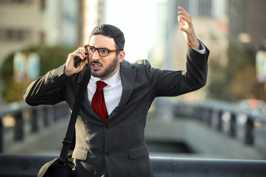 Stress panic fiery enraged business executive shouting angry on phone