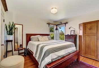 Bedroom interior with queen size wooden bed
