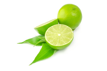 Two halves and whole lime isolated on white background with leaves
