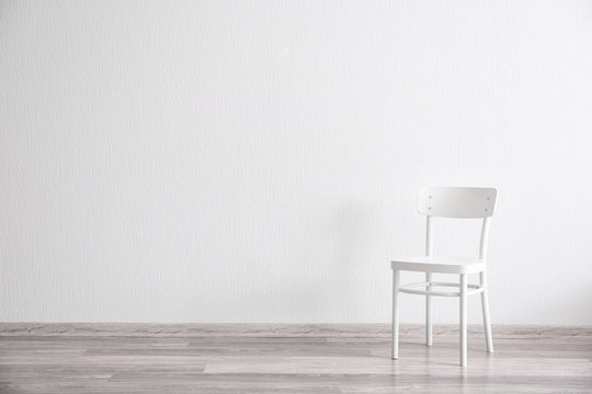 White chair in light room interior
