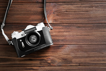 Vintage photo camera on wooden table