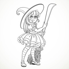 Cute little girl dressed as witch with a broom standing on a whi