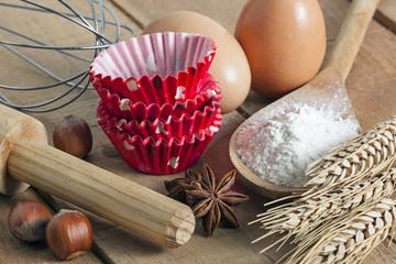 baking utensils on wood background - food