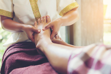 Thai foot massage alternative medicine therapy with Thai herb ar