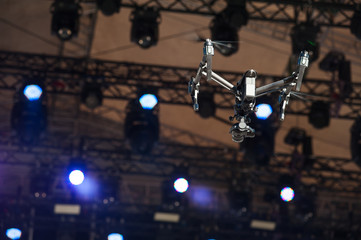 Drone flies over stage/Drone with camera flying over the scene and shoots video