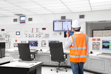 Electrical engineer working at control room of a modern thermal