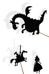 Shadow puppets of dragon, princess and knight on white background