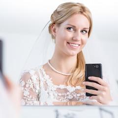 Beauty bride taking photo of herself