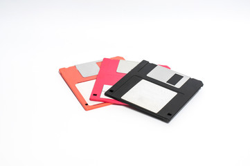 Old floppy disk put on white background,soft focus.
