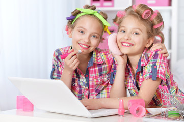 Cute  tweenie girls  with laptop