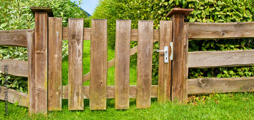gartenzaun mit t r im gr nen woden fence on a garden stock photo and royalty free images on. Black Bedroom Furniture Sets. Home Design Ideas