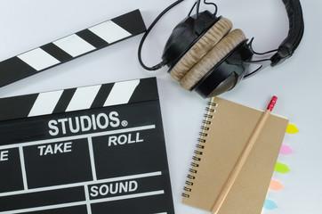 Slate film and notebook headphone white background