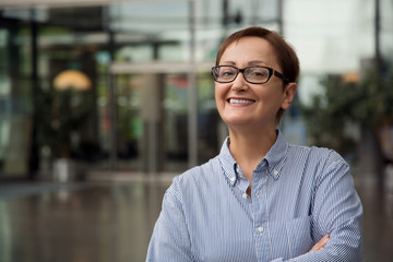 Older  business woman portrait. Professional headshot of businesswoman in the office. Middle-aged female 40 50 years old wearing glasses. Portrait of manager, teacher., principal, customer service