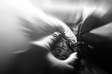 Tattoo painting. Close up. Black and white image.