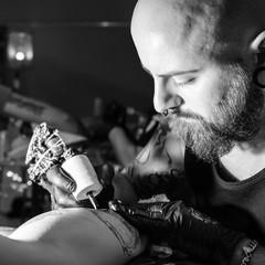 Tattoo artist making a tattoo
