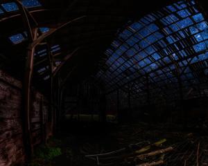 Looking Through an Abandoned Barn at Night