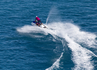 jet ski on the surface of the water at a speed of