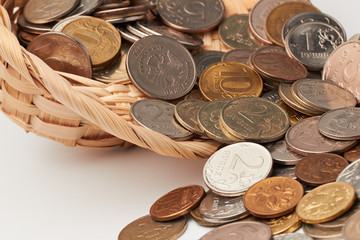 Wicker hat with coins./Wicker hat with coins.