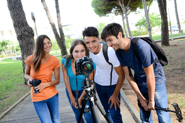 group of young photography students with teacher during outdoor photo course