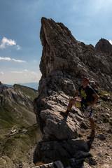 Wanderer enjoys a break after ascend towards Lampsenspitze in the Karwendel mountains