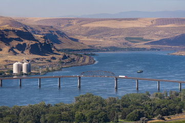 The Sam Hill Memorial Bridge. This is a steel truss bridge that carries U.S. Route 97 across the Columbia River between Biggs Junction, Oregon in Sherman County and Maryhill, Washington.