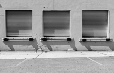Isolated image of warehouse garage doors. Image of multiple freight truck doors. Steel gated garage doors in docking bay. Industrial design and art of factory doors.