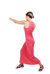skinny woman funny fights waving his arms and legs. slender woman in a long red dress strikes a hand.