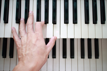 left hand playing lower music keyboard