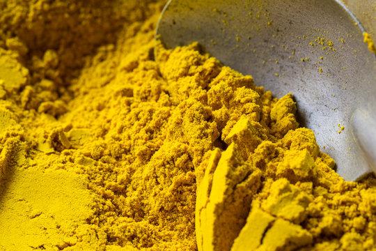 yellow powder color of Turmeric herbal.