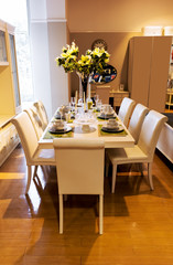 dining table and comfortable chairs in home with elegant table setting