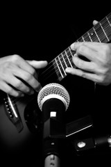 musician hands playing & recording acoustic guitar