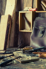 Chisels and carved piece of wood in traditional carpenter worksh