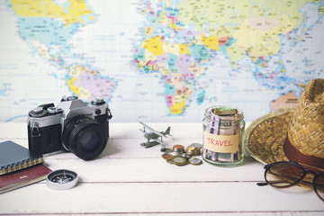 Collecting money for travel with accessories of traveler
