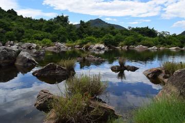 fresh Ham Ho stream with rock reflect on water surface in Binh Dinh, vietnam