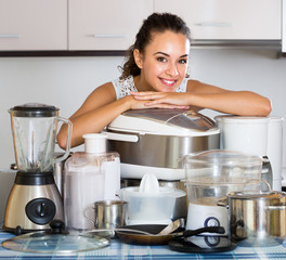 Happy housewife with blender and multicooker
