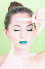 Girl posing with professional trendy make-up as photo gesture