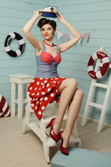 Young girl dressed at pin-up style