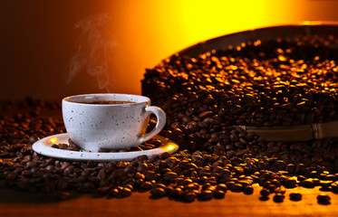 black coffee and roasted beans