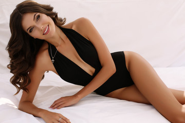 gorgeous sexy woman with dark hair in elegant swimsuit