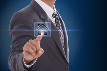 Businessman hand pressing home symbol