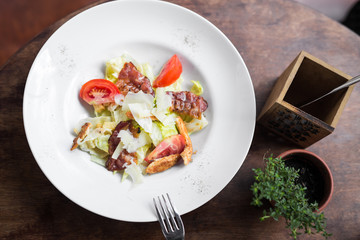 Caesar salad with chicken and tomato