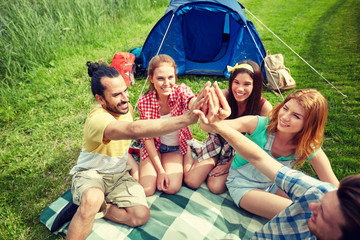 happy friends making high five at camping