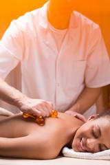 Massage device amplifying masseur's strength