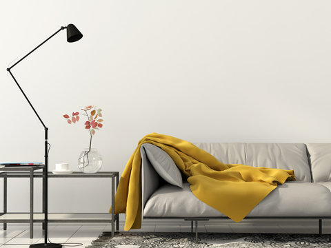 living room with white sofa with yellow blanket