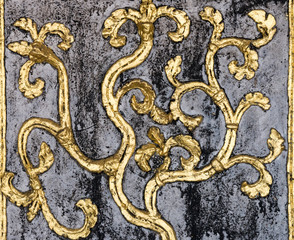 Golden flower stucco.