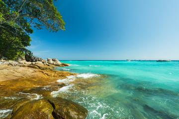 Wall Mural - Beautiful Stone beach and water splash at Tacai Island,Thailand