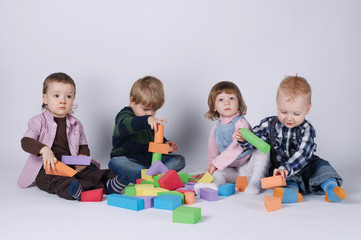 happy children playing with cubes
